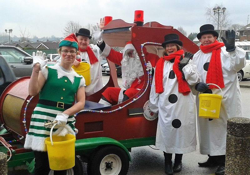 Members of Turton and Bolton-le-Moors Rotary Clubs give a cheery wave around the Christmas sleigh as they make a collection for local and rotary charities outside Morrisons Superstore at Harwood